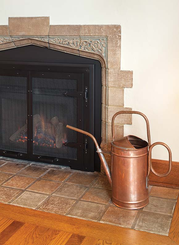 The original Batchelder-tiled fireplace in the living room was carefully restored.