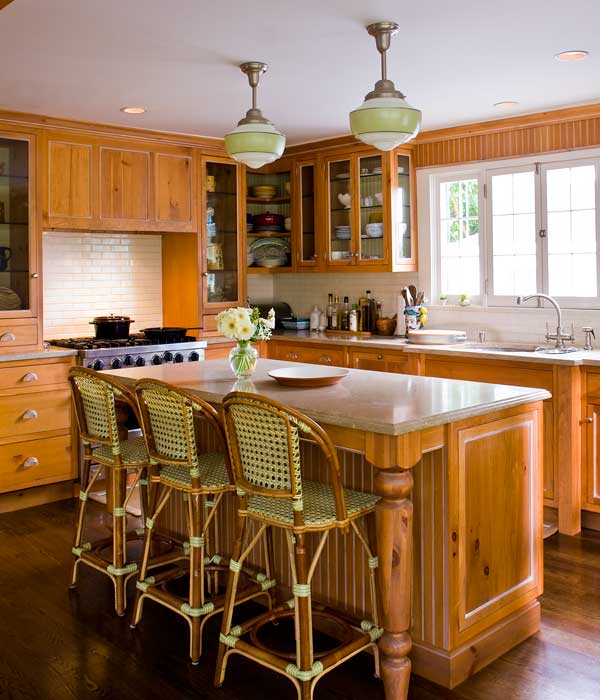The owner designed the kitchen with lots of glass to reflect light.