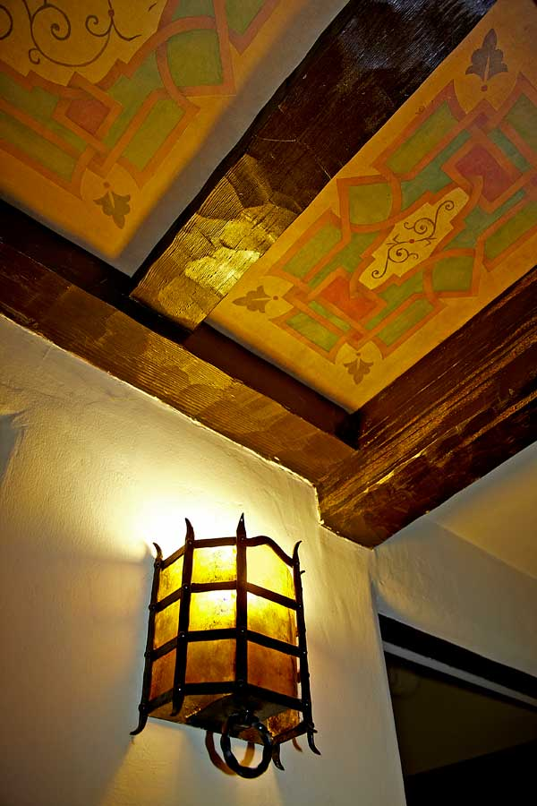 The painted ceiling in the hall, added by the previous owner, is based on decoration in California missions. The fixture is original.