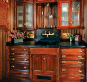 The pantry has the larger sink. It is natural soapstone; the owners were not willing to install wood countertops in wet areas.