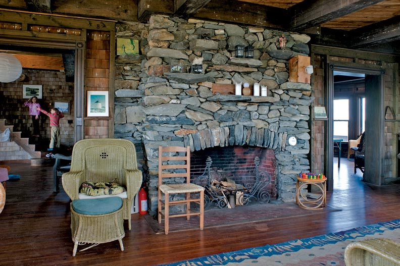 The parlor is anchored by a massive beach-stone fireplace.