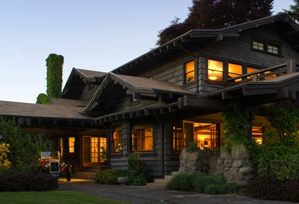 The picturesque Craftsman house has broad, overhanging eaves and a wide front porch.