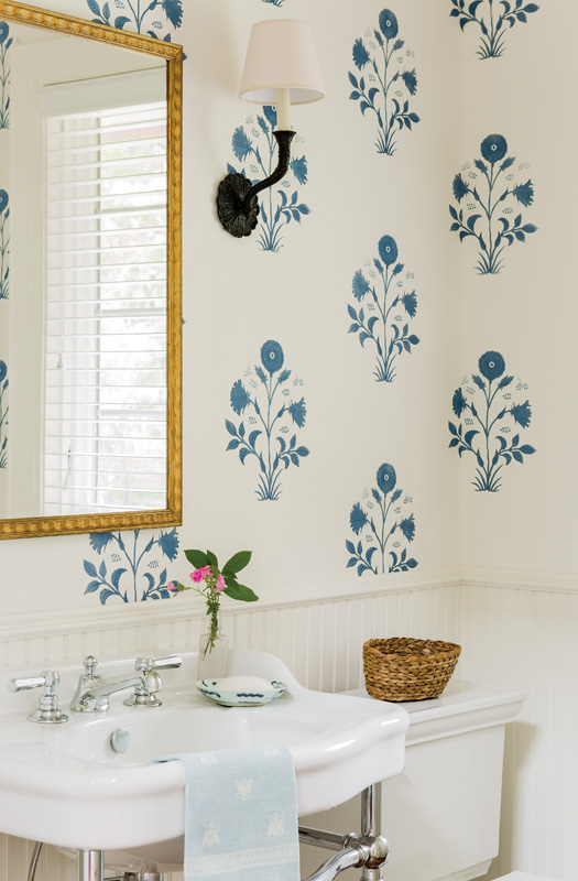 The powder room is papered in a cobalt blue Les Indiennes block print.