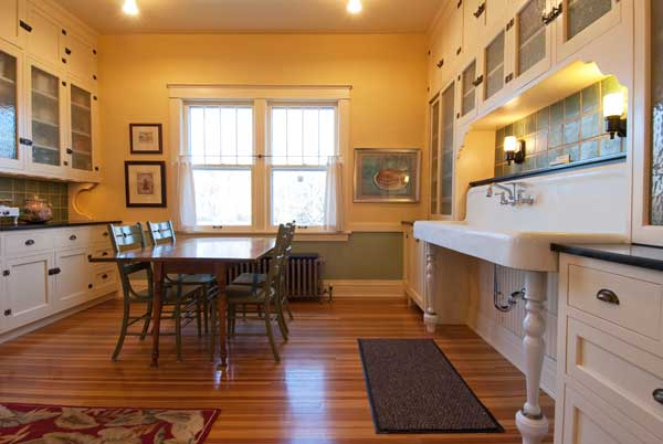 The remodeling brought back the room's spaciousness and lets in lots of light. New cabinets at left match originals over the sink.