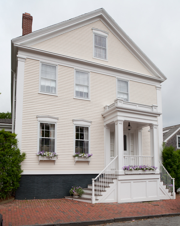 The renovated kitchen fits the vernacular Greek Revival house.