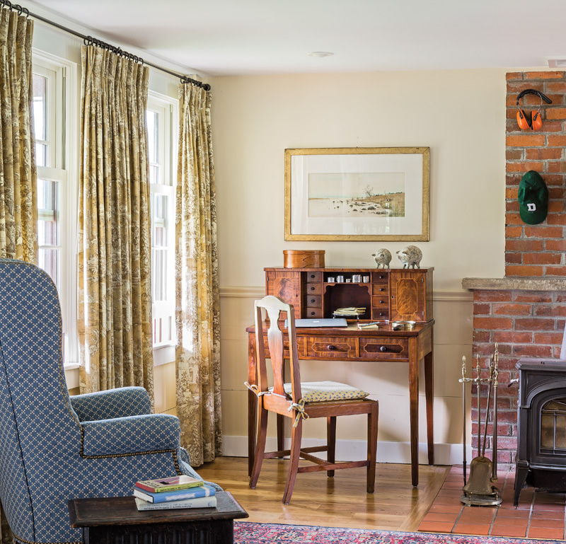 The room is furnished with one of the homeowner's antique desks.