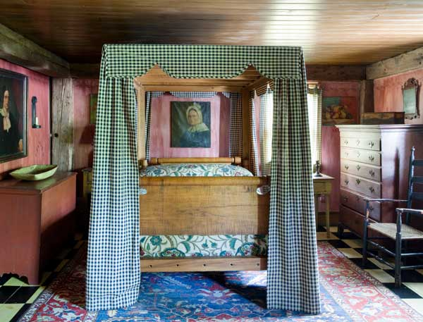 The six-drawer chest, in its original finish, is a cherished possession of the LeBeaus. The couple hired a local craftsperson to make bedhangings like those that would have been found on their antique bed.
