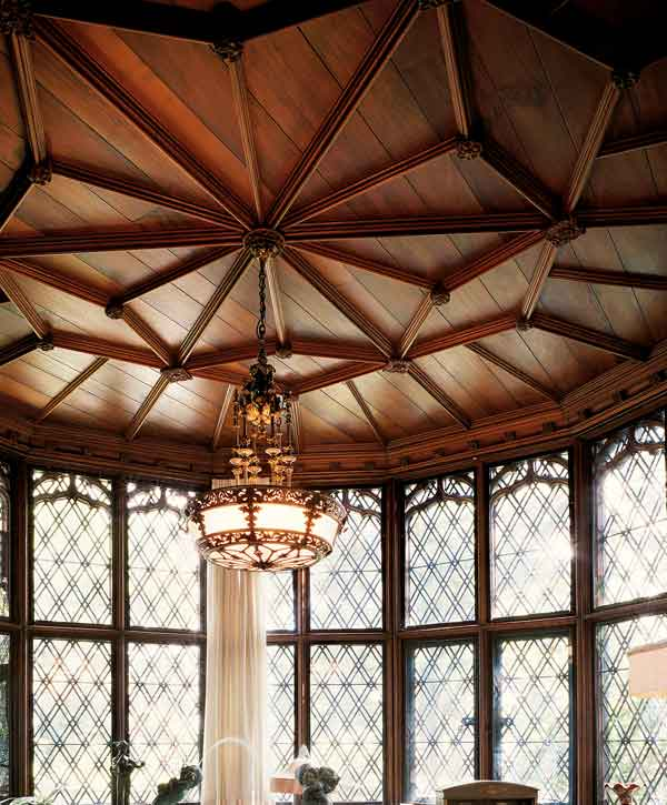 The solarium at Tudor exemplar Stan Hywet Hall has a sandalwood ceiling with molded wood battens.