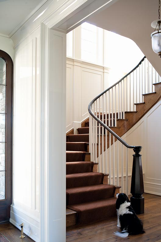 The staircase has classical detailing.