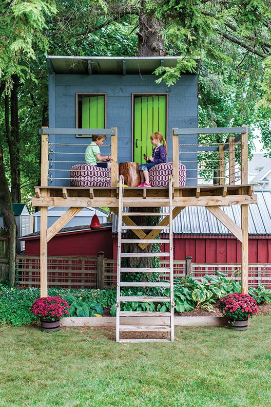 The tree fort is the perfect nostalgic hideaway for Day's children.