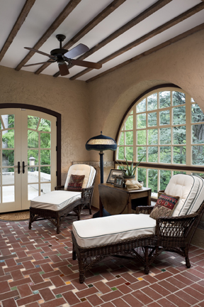 The veranda's brick floor is dotted with colorful Henry Chapman Mercer tiles, exactly re-creating Will Price's 1904 design.