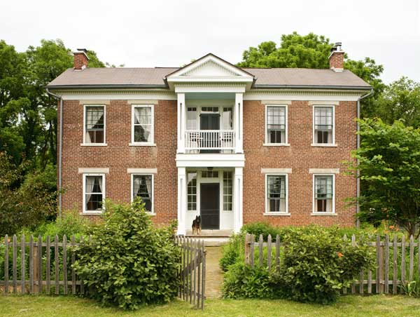 The vernacular brick house with Greek Revival details dates to circa 1858.