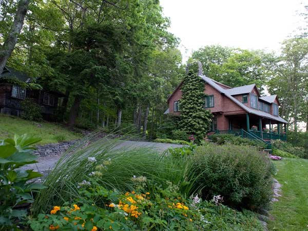 The Whim was designed by Frederick Delafield in 1908. The winding bed of perennials along the approach to the house is intact, though plants have changed over the years.