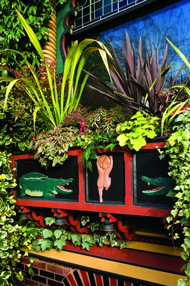 The whimsical window box featuring two alligators chasing an anxious baby.