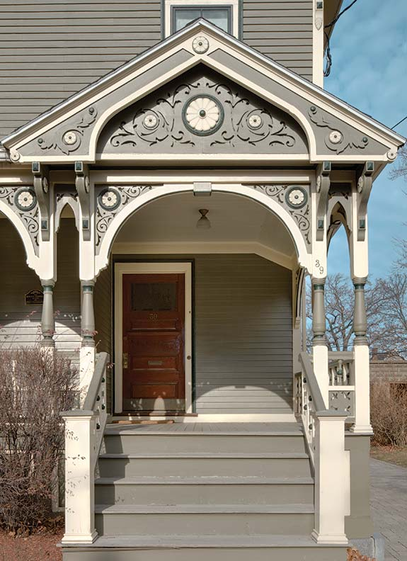 The wraparound porch survived years of adversity, including being sheathed in plywood.