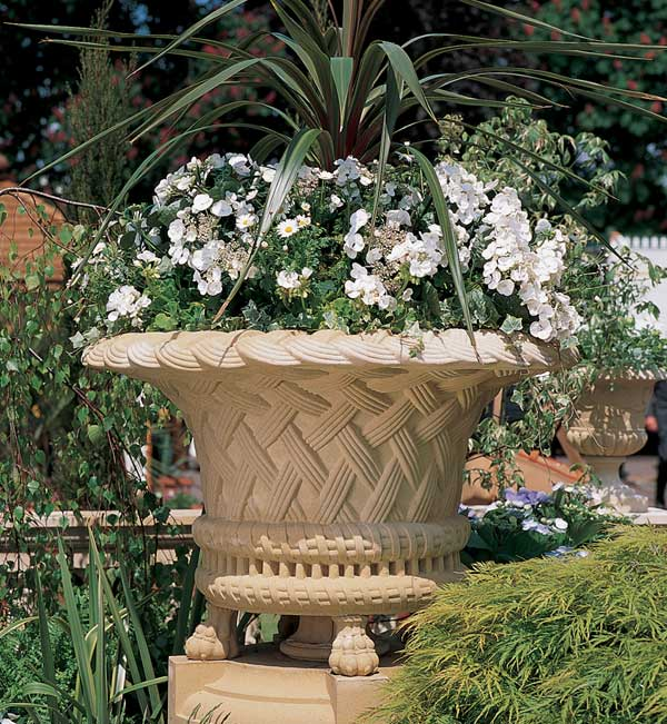 This clay basketweave jardinière is also from Haddonstone.