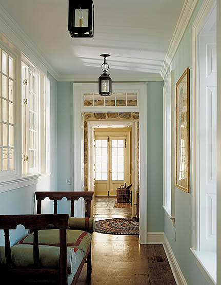 This hallway just off the front entrance hall in the new addition is flanked by a row of windows looking into the kitchen. The three-piece beaded door casing with backband is historically appropriate, as are the window casings.