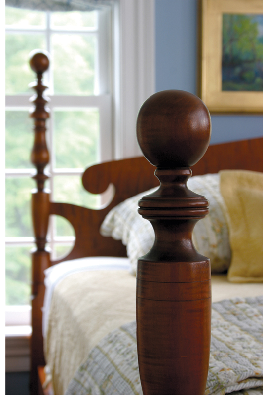 This is an antique-reproduction cannonball bed from Eldred Wheeler.
