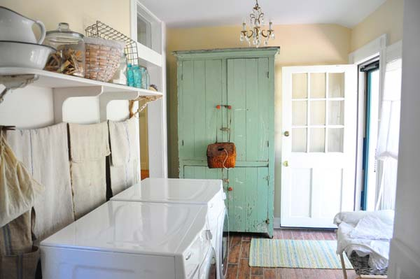 This laundry room flanks the kitchen of a restored 1865 Missouri farmhouse. Plumbing is cleverly hidden behind a curtain of cotton cording and old grain sacks. Photo: Carol Spinski/raisedincotton.com