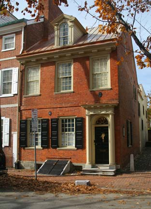 The house that carpenter Thomas Nevel built for himself in 1770 has a decorated dormer window and an uncommon mutule cornice—good Georgian features.