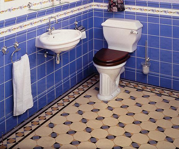 An installation of geometric tiles in a restored Victorian-era bath.