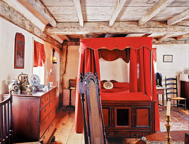 In the 1690 portion of a Massachusetts house, the upstairs bedroom has shouldered gunstock posts in the corners and whitewash on the old timbers. (Photo: Paul Rocheleau)
