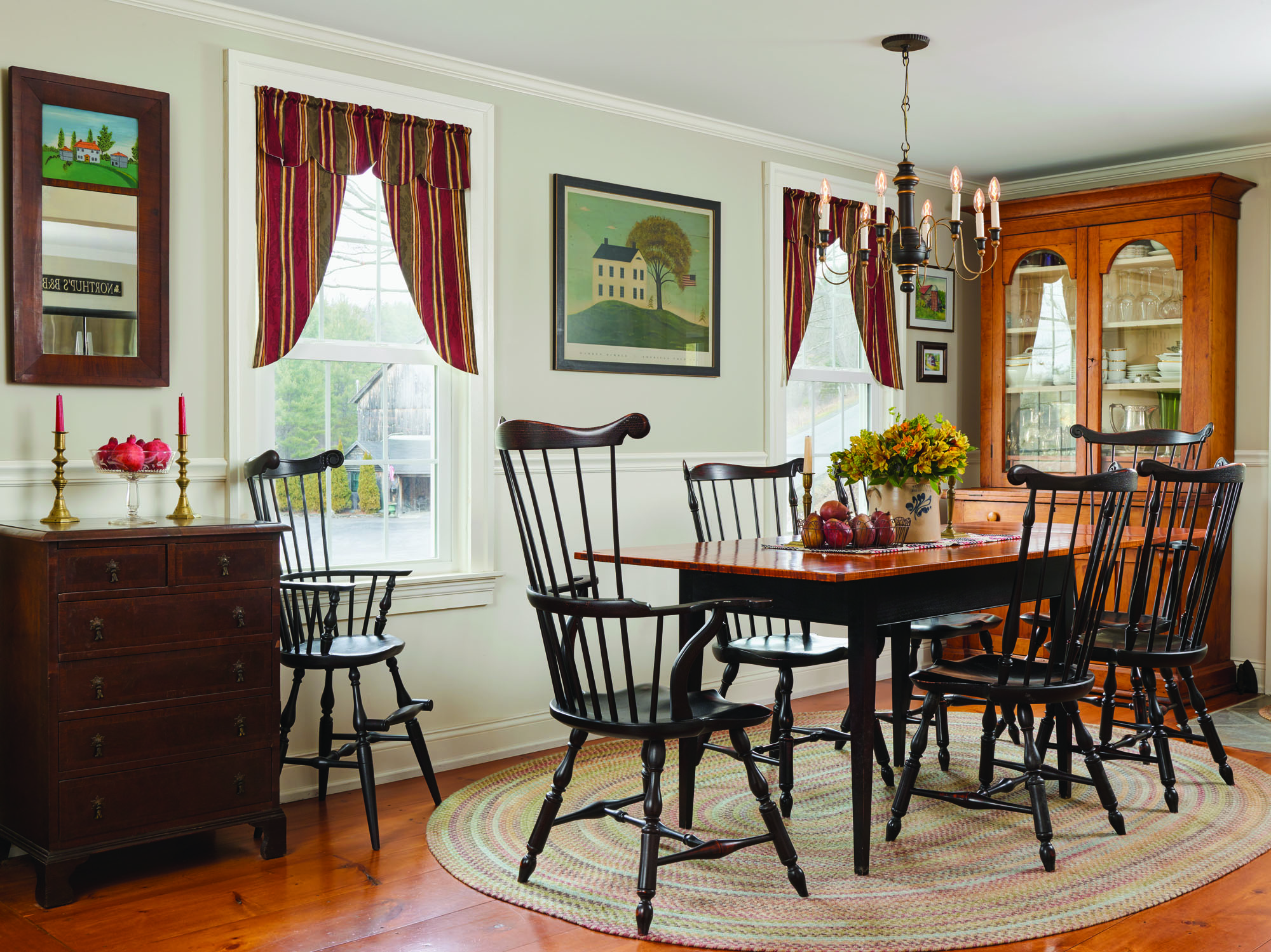 The formal dining room is adjacent to the kitchen space added in 1876. Just outside the windows is the barn where the owner's grandparents kept their dairy cows. WIth new wainscoting and window frames in period style, the barn functions as an office and showroom.