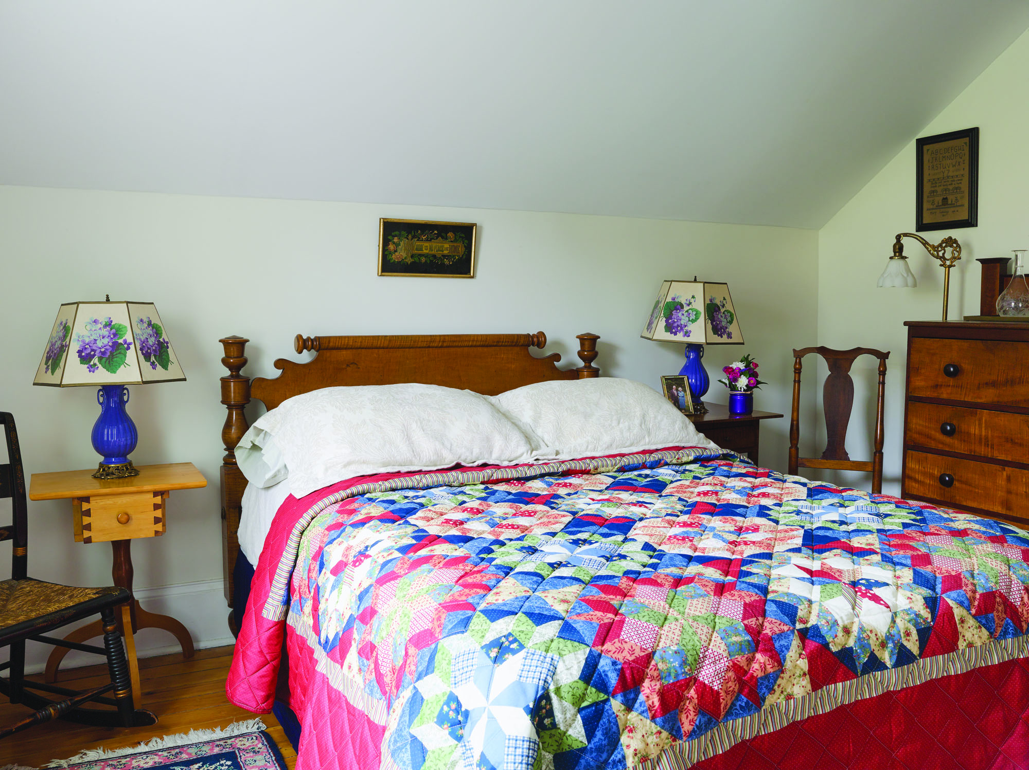 The guest bedroom is in the 1876 section of  the house. To  accompany the 1820s tiger maple bed, the owner made the stand from tiger maple and cherry.