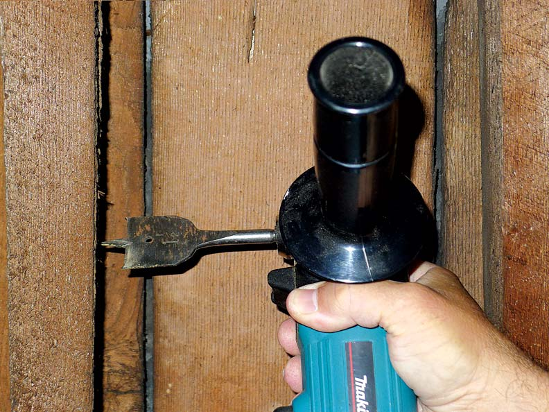 A right angle drill fits easily into the space between wall studs.