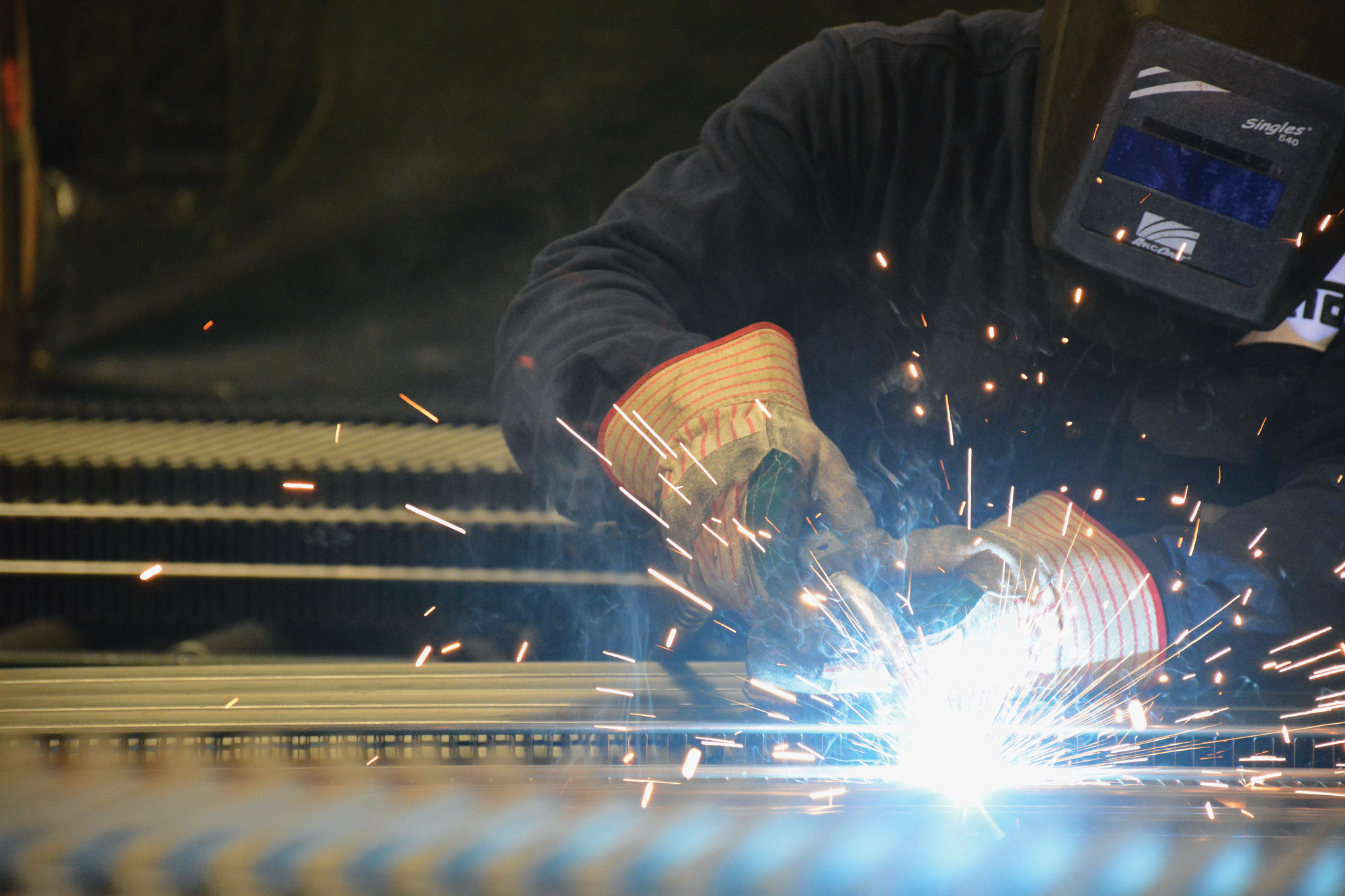 At Runtal North America's factory, Duane Barnard TIG-welds fins to the front panels.