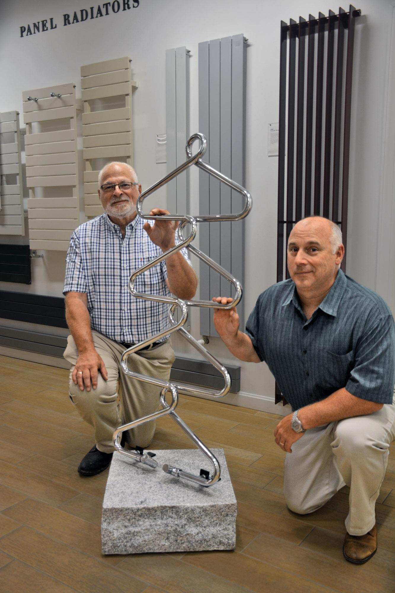 Owen Kantor and Jonathan Wiberg in the Runtal showroom, with a custom towel radiator.
