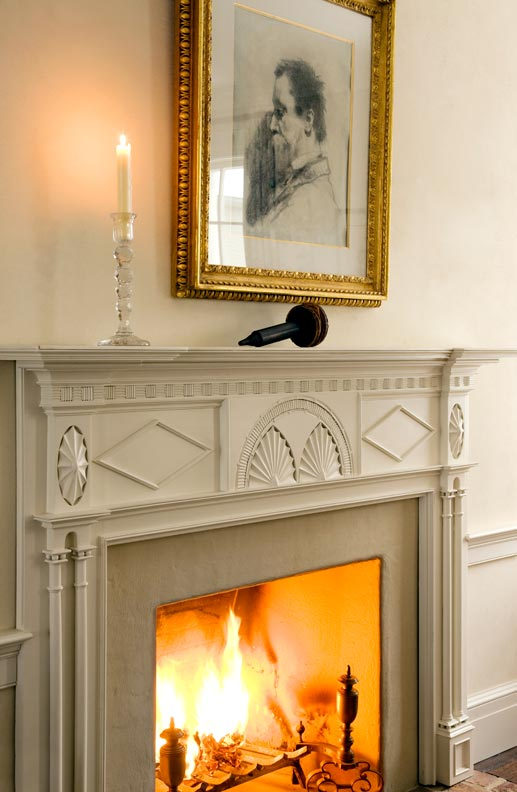 For a new old house in New York, architect Gil Schafer replicated this original mantelpiece and placed both in the living room.