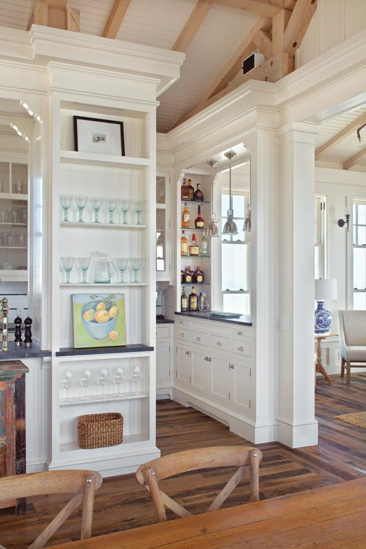 Traditional moldings create sophistication in the galley kitchen.