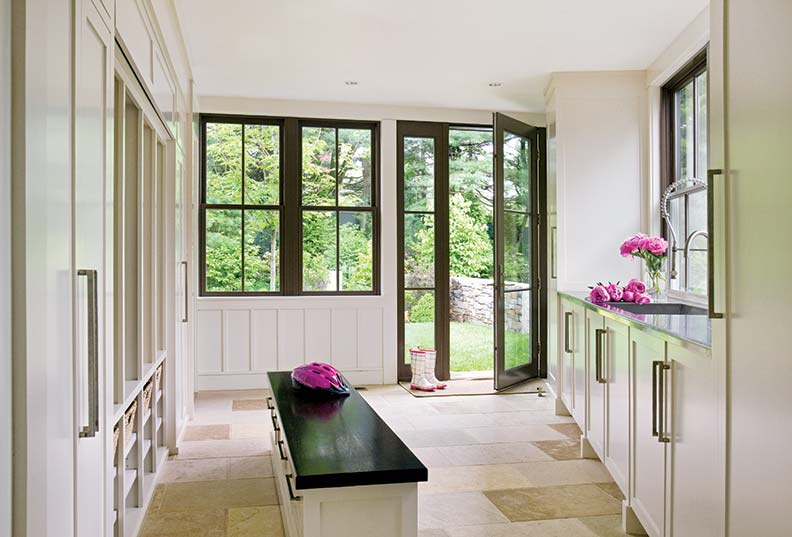 This mudroom was designed by New England architect Mark Hutker.