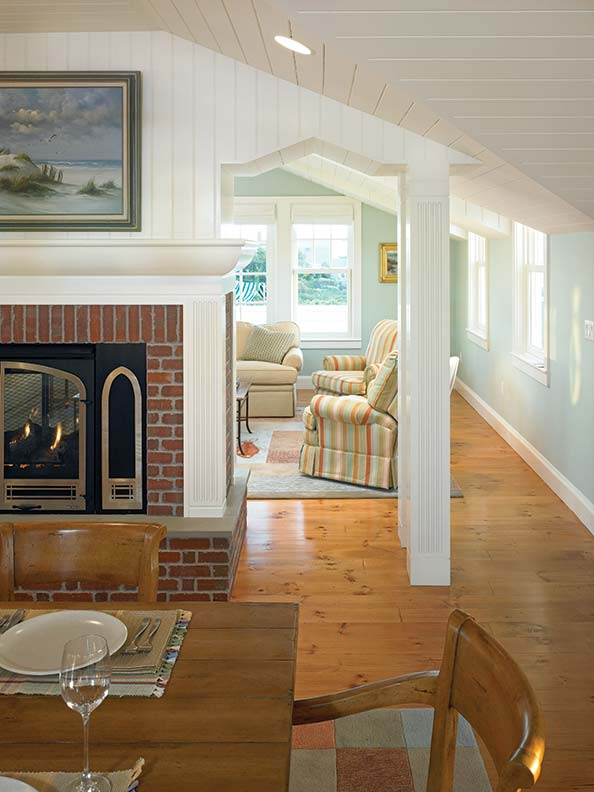 Interiors offer a simple cottage feel with vertical beadboard, wood floors, and traditional mantel moldings.