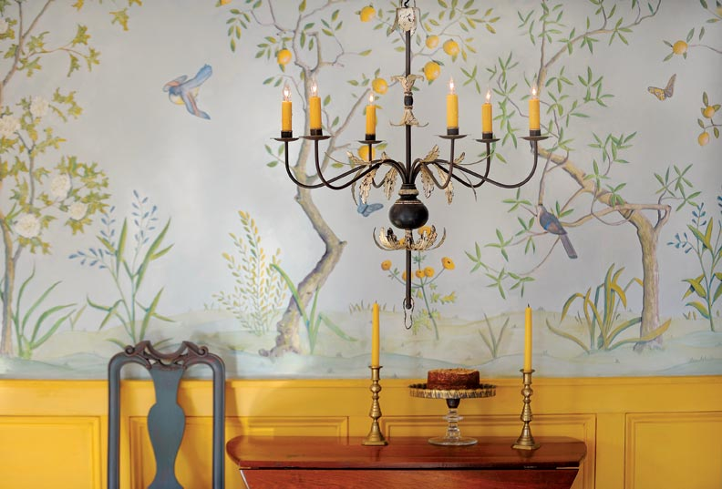 The Acanthus Leaf chandelier has 22-karat gold leaf bands on the wood turning and the leaves.