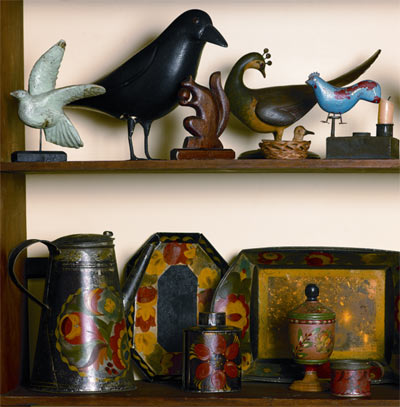 A shelf full of early Pennsylvania toleware includes a rare piece with crystallization. right, top: An early-20th-century tin pan with tole decoration, from Hidden Treasures.