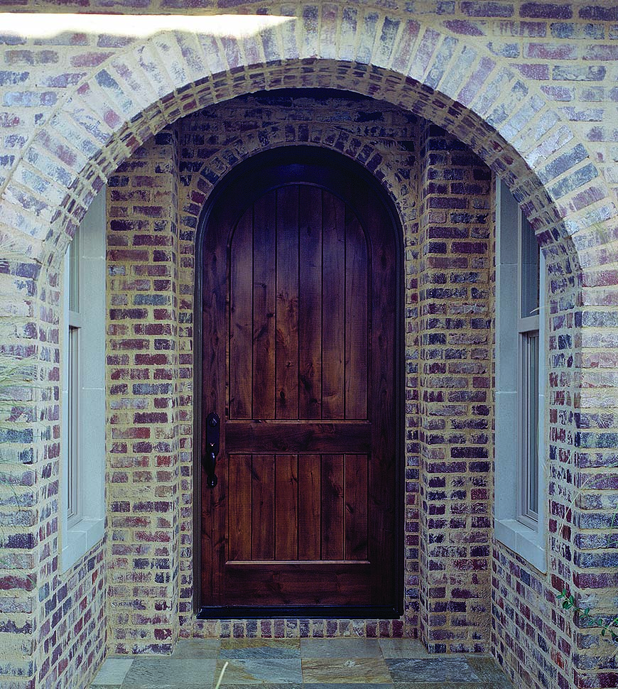 Tudor entrances are capped by curves.