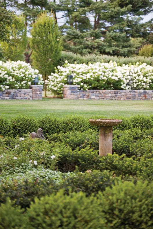 Parker included structural elements in the garden in the way of fencing, urns, walls, and fountains.