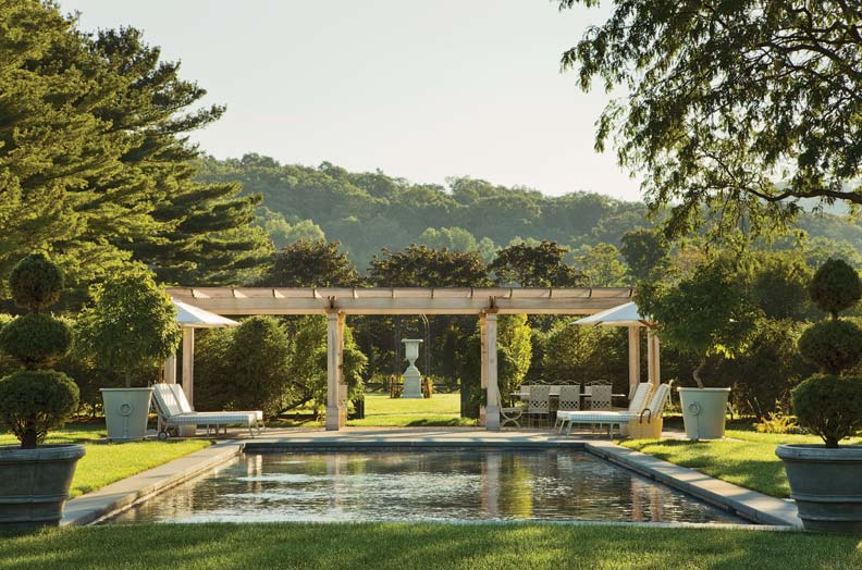 Parker incorporated a pool complete with pergola and outdoor dining area.