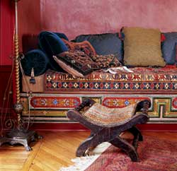 Cozy corners piled high with pillows in rich and exotic fabrics were a favorite treatment in late Victorian rooms. Gross & Daley photo