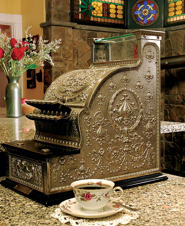 """We joke with our guests that we're going to charge them for the nice dinner they just had,"" says Bruce Rosenbaum of the antique cash register that sits on the island in the couple's kitchen."
