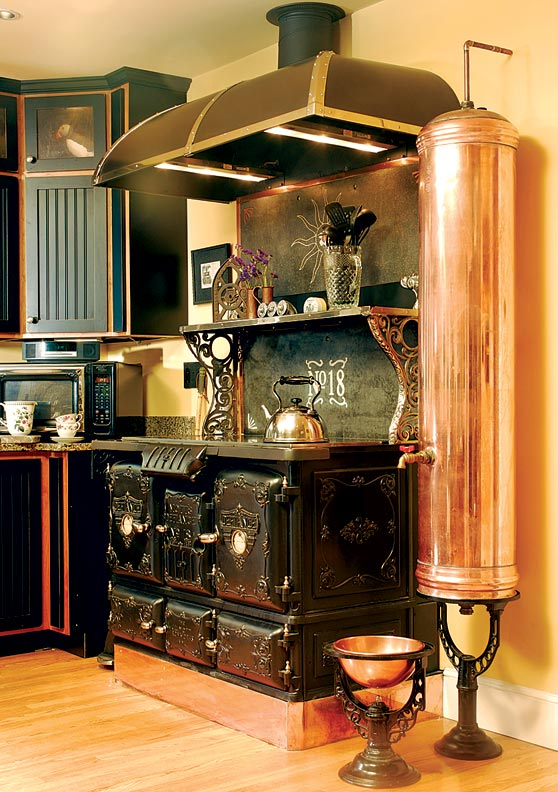 David Erickson of Erickson's Antique Stoves used the stove's central firebox to disguise the wiring and controls for the new electric cooktop.