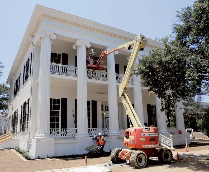 Workers put the finish coat of paint on the columns in June.