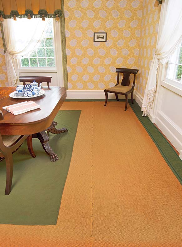 Another view of the dining room in the 1818 Jonas More House at the Farmers' Museum, Cooperstown, New York. A drugget is laid over the birdseye carpet. Wallpaper is by Adelphi.