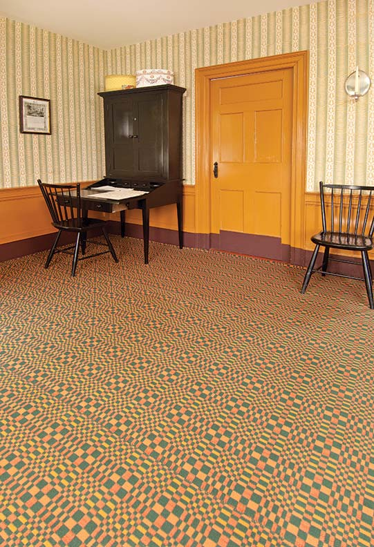 A plaid ingrain carpet in another room at the More House.