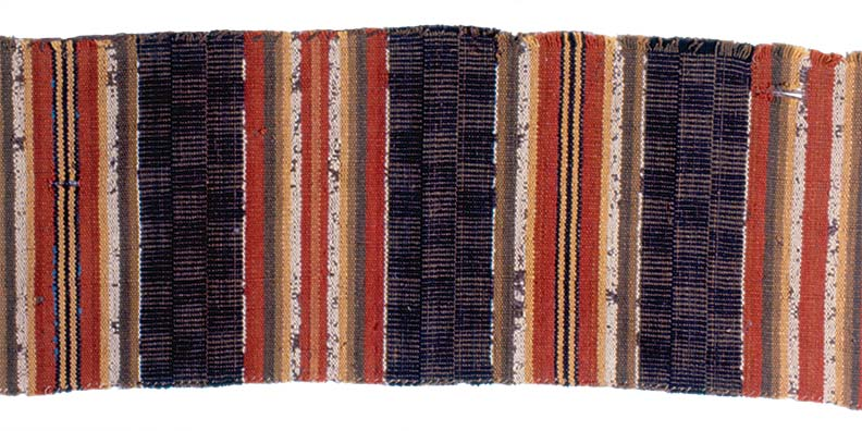 Fragment of striped carpet with wool warp and tow weft, made 1815 by Mrs. Deliverance Belknap of Sturbridge, Massachusetts.