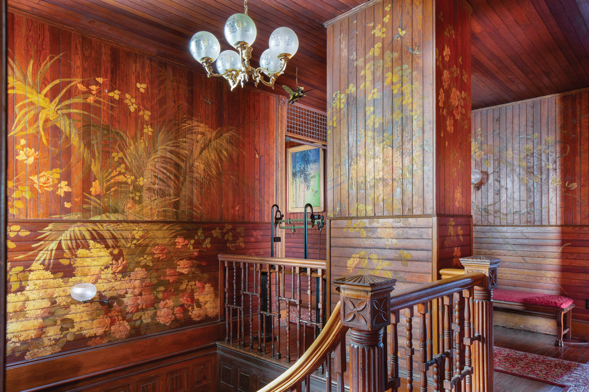 The artistic talents of nameless  artists of the late-19th century  are in full flower at the top of  the stairs, which lead to guest rooms.