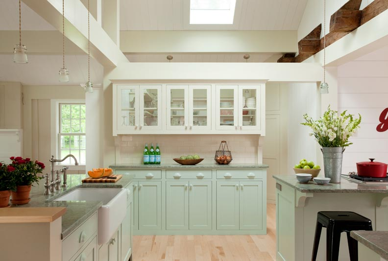 The kitchen dish cupboard has glass cabinets as well as glass at the back of the shelf to allow for more light through the pantry skylights.