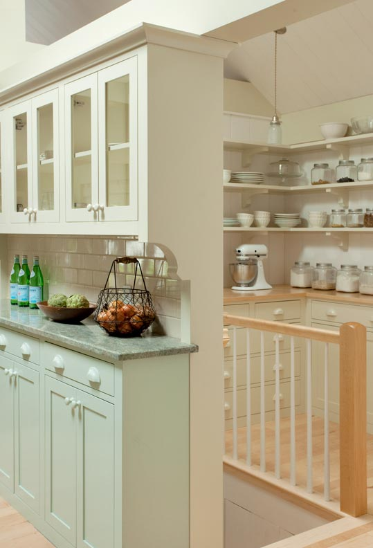 A stairwell in the dish and storage pantry leads to a laundry room.